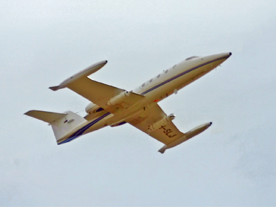 Lear jet with ASRAAM guidance section mounted in pod under starboard wing (LHS of photo) and camera for recording test environments in infrared imagery mounted in pod under port wing (RHS of photo).