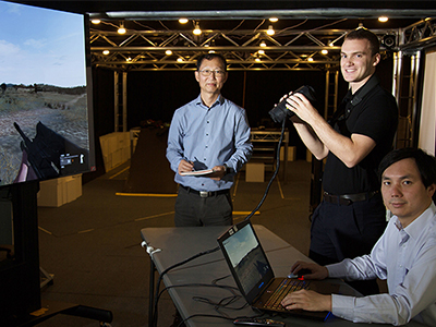 Just how does one build a convincing virtual landscape? Defence scientists Dr Bin Lee (LD) and Jay Yu are facing that challenge.