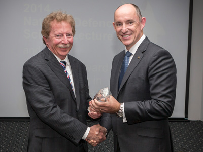The Assistant Minister for Defence, Stuart Robert (right) awards Dr Stephen Burke with the 2014 Minister's Award for Achievement in Defence Science.