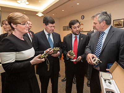 Chief Defence Scientist Dr Alex Zelinsky (right) demonstrates the new counter improvised explosive device (IED) equipment to (from L-R) Senator for Western Australia the Hon Linda Reynolds, Minister for Defence the Hon Kevin Andrews and Ambassador for the Embassy of Afghanistan, H.E Nasir A. Andisha.