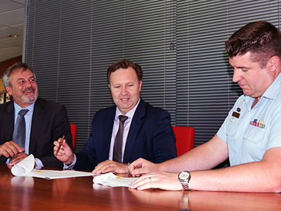 Strategic Alliance signing between DST Group and QinetiQ. (L-R) Chief Defence Scientist Dr Alex Zelinksy, Greg Barsby, Managing Director, Qinetiq and WGCDR Ben Main, Air Force (DGTA).