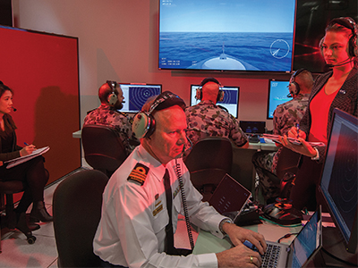 DST researchers working alongside Navy personnel in the Combat System Integration Laboratory, exploring UAS integration into RAN ships.
