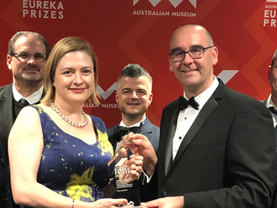 Chief Defence Scientist Professor Tanya Monro presents the Eureka prize to Team Grey Scan