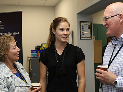 R&I Graduate Monique Hollick (middle) talking with DST Chiefs Dr Janis Cocking and Dr John Riley.