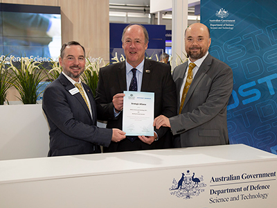 L-R: David Perry, Northrup Grumman USA; Mike Gallagher, Acting CEO Northrup Grumman Australia and Acting CDS Todd Mansell at the signing
