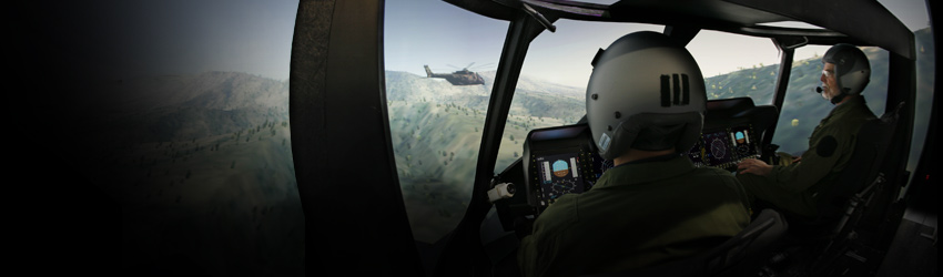 Helicopter pilots use a helicopter flight simulator.