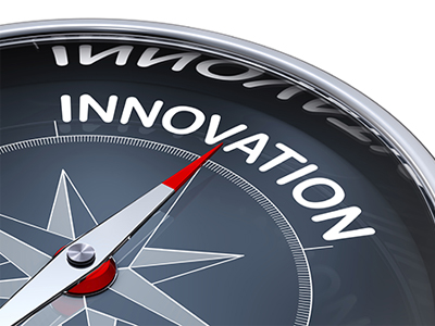 A stock image of a compass with the needle pointing to the word 'innovation'
