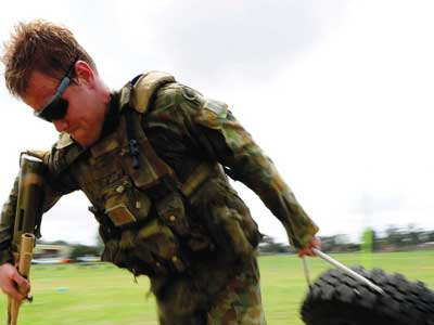 A soldier dragging along a tyre as part of an exercise.