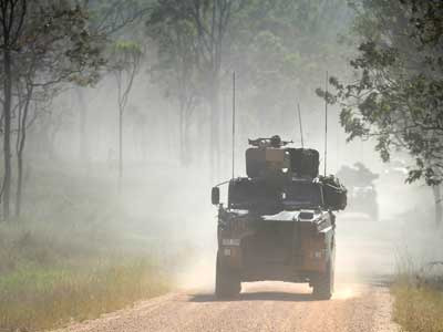 Three Bushmaster on the move during a MTF-3 Mission Rehearsal Exercise prior to deploying to Afghanistan.