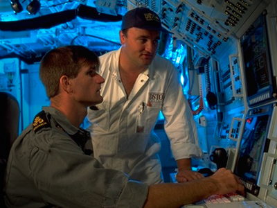 Picture showing Australian Naval Ships' officers looking at an undersea computer system