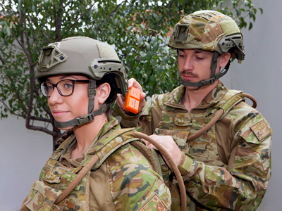 Solider placing fight recorder on fellow solider