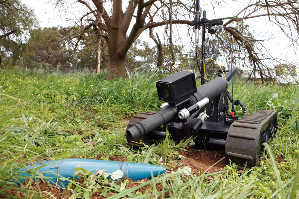 DSTO has designed and successfully demonstrated a number of small Unmanned Systems, including the Spiker remotely controlled tracked robot which deploys a number of different devices to render an Improvised Explosives Device (IED) safe. It has two cameras mounted on the device to allow positioning of the explosive and other devices.