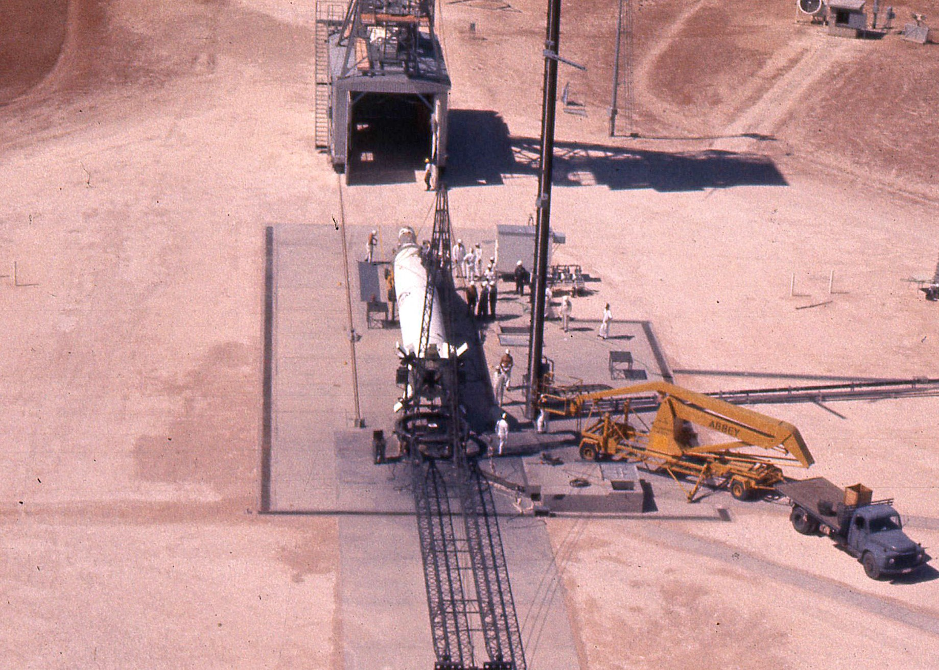 The Redstone rocket prior to its being lifted to the vertical position for launch at Woomera. The rocket was painted white for optical tracking purposes and the satellite attached while the Redstone rocket was still in the horizontal position. Photo courtesy of Prof John Carver.