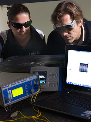 Two DST Group experts working on fibre laser sensors.
