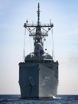 HMAS Sydney at anchor near Pulau Tioman, Malaysia during Exercise BERSAMA SHIELD 2014.