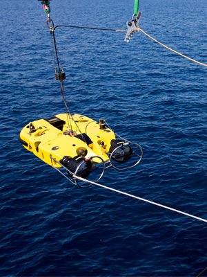 HMAS Huon recovers its Double Eagle Unmanned Underwater Vehicle following a successful mine shape identification during the Mine Counter Measures and Diving Exercise 2014.