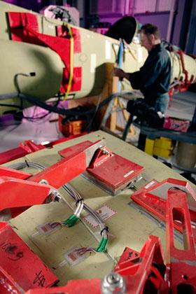 An engineer preparing the Hawk Lead-in Fighter rig.