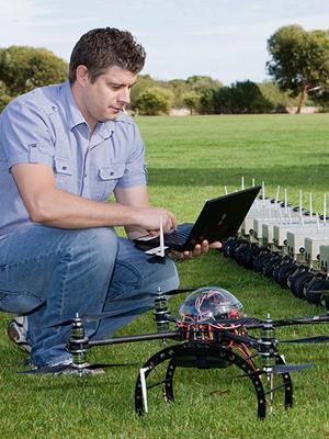 DST Group's Tom Stevens adjusts the OPAL communication algorithms.