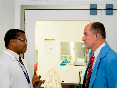 A DST Group scientist providing advice to the Assistant Minister for Defence, Mr Stuart Robert.