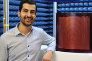 Joel Patniotis in an anechoic chamber with a sample DSTG-designed artificial impedance surface. One day reconfigurable antenna surfaces like this could be embedded in the surface of air, sea and land platforms.