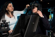 Maria Gavrilescu and Peter Gibbs prepare to conduct an experiment on visual performance with a night vision device used in Army aviation.