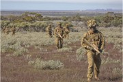 Members from the 1st Brigade, Australian Army, on patrol during Exercise Boars Run at Cultana Training Area.