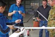 DST Group and Army personnel with the Australian-developed unmanned aerial vehicle, Aerosonde.