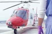 A stock image of a doctor waiting on tarmac for a aeromed helicopter.