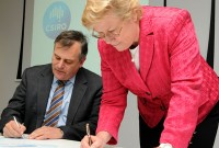 Chief Defence Scientist Dr Alex Zelinksy and CSIRO Chief Executive Dr Megan Clark signing a Strategic Relationship Agreement between DSTO and CSIRO.