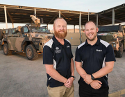 Operations analyst Jeff Seers, left, and science and technology liaison officer Matt Randell at the ADF's main operating base in the Middle East. Photo: Leading Seaman Craig Walton