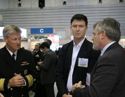 Vice Admiral Robert L. Thomas, Commander of the US Navy 7th Fleet in conversation with CDS Dr Alex Zelinsky (right) and Brendon Anderson, Head DSTO Hydrodynamics.