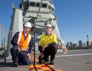 Image of Dr Andrew Ang and Mr Matthew Leigh preparing for the on-board trials on HMAS Canberra.