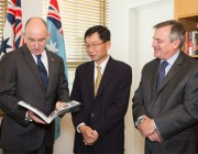 L-R, Assistant Minister for Defence Stuart Robert, Mr Tan Peng Yam, the Chief Executive of Singapore's Defence Science and Technology Agency and Chief Defence Scientist, Dr Alex Zelinsky at Parliament House, Canberra.