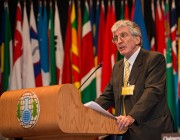 Dr Bob Mathews accepting his award at The Hague. Photo courtesy of Henry Arvidsson/OPCW.