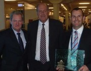 (L-R) Joe Rears, Director Aviation (One Atmosphere), Defence Minister Senator David Johnston and Tim Lyons, Managing Director (One Atmosphere) with the innovation award.