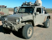 A modified Jeep fitted with a DST Satellite-On-The-Move (SOTM) unit (the dome on the rear tray).