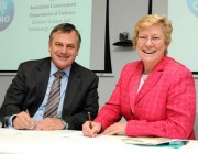 A photograph of Chief Defence Scientist Dr Alex Zelinksy and CSIRO Chief Executive Dr Megan Clark signing the Strategic Relationship Agreement.
