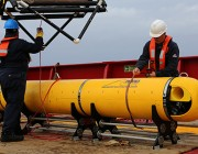 Chris Minor secures the Phoenix International Autonomous Underwater Vehicle (AUV) Artemis after the AUV completed the final mission prior to ADV Ocean Shield's return to port for replenishment during the seabed search for missing Malaysia Airlines flight MH 370.