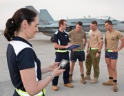 Alison Fogarty examines data recorded on Defence Science & Technology Group equipment as part of a heat study being conducted at Australia's main operating air base in the Middle East Region.