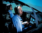A photograph of a pilot taking part in an ALR 2002 radar warning reciever flight simulation