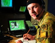 Australian Army soldier Signaller Liam McInerney of the 7th Combat Signals Regiment, monitors the battle management system in the joint operations room during Exercise Talisman Saber 2013, Queensland.