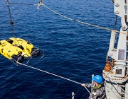 Image of HMAS Huon recovering its Double Eagle Unmanned Underwater Vehicle following a successful mine shape identification during a Mine Counter Measures and Hydrography exercise.