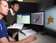 DST researchers with graphic of computer modelling