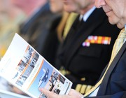 An image of a man reading the Defence White Paper.