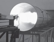 A photograph of a static firing in DST Group's rocket motor test facility.