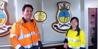 Anthony Woolley and Jenny Liu aboard HMAS Warramunga.