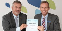 Chief Defence Scientist Dr Alex Zelinsky (left) and Airbus Group Australia Pacific Managing Director Dr Jens Goennemann (right) holding the newly signed strategic alliance.
