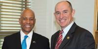 (L-R) Dr Reginald Brothers and Assistant Minister for Defence Stuart Robert.